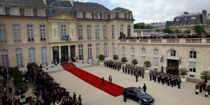 France's outgoing President Nicolas Sarkozy leaves the Elysee Palace after the handover ceremony with new President Francois Hollande, at the Elysee Palace in Paris